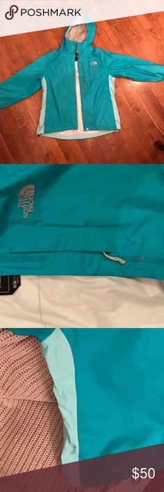 NORTH FACE RAIN JACKET: Worn once! Turquoise blue rain jacket with light turquoise panels on the side. White mesh lining. Velcro wrists, Velcro up the middle, and at the top at the base of the hood. Not a single flaw on this jacket! The North Face Jackets & Coats