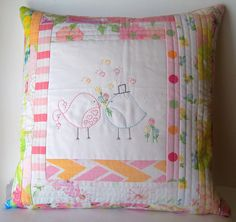 Embroidered pillow with vintage sheets