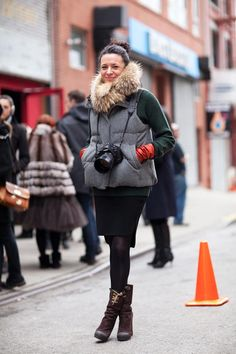 Street Style - Garance Dore's cozy vest is sophisticated with a pencil skirt and booties.