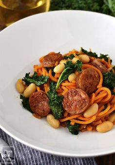 Chicken Sausage, Kale and White Bean Sweet Potato Noodle Skillet is a quick and healthy gluten-free dinner recipe. Ready in 20 minutes or less and full of protein, fiber, and vitamins!   iowagirleats.com