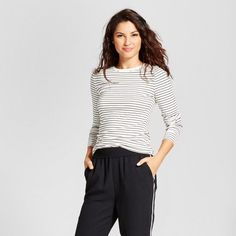 When you're in search of a timeless piece you can wear through the seasons, pick up this Fitted Long-Sleeve Crew T-Shirt from A New Day™. The classic stripes look great when worn with white linen pants in the summer or under a cable knit cardigan in the winter. For a truly bold look, don't be afraid to mix prints — pair with a floral print midi skirt and wedges for a unique style that's sure to get you noticed.