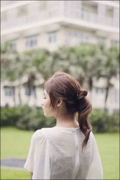 Create an interesting ponytail by letting some hair fall out of the bun.