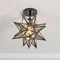Moravian Star Ceiling Light - I've wanted one of these since I can remember. I finally bit the bullet and ordered one for my foyer. I can't wait!