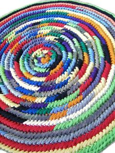 Toothbrush rug made with colored tees, and a crocheted edge.