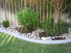 backyard idea with river rock