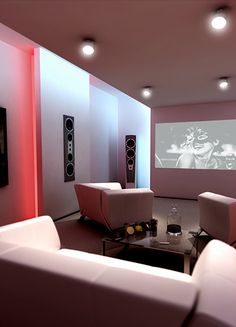 A more modern take on a home cinema room with individual pieces of furniture so that the room can be changed to accommodate a multitude of uses.