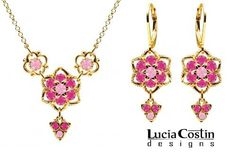 European Style Lucia Costin Necklace and Earrings Set Made of 14K Yellow Gold Plated over .925 Sterling Silver with Light Pink and Fuchsia Swarovski Crystals Surrounded by Twisted Lines, Set with Lovely Charms Lucia Costin. $125.00. Style takes wings in this lovely jewelry set that have a graceful flower shape. Decorated with light rose and fuchsia Swarovski crystals. Flowers and fancy ornaments beautifully combined. Handmade in USA unique jewelry set. Lucia C...