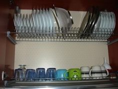 Another Italian dish cabinet, over the sink, where the drying dishes can just drip and not have to be moved anywhere else. Efficient!