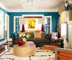 We love the bright, bold blue color in this living room! Check out before and afters of these living room makeovers.