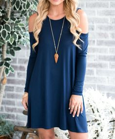 We have gotten so many requests for more cold shoulder dresses, we have added another style! This one is long sleeved, and the fabric is super soft. This is sure to be one of your new favorites! Desig