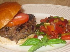 Outta the Park Burgers:  mix sauce, chopped red onion and fresh chopped cilantro into ground beef. Use sauce instead of ketchup, add big slice of heirloom tomato.  Made with Outta the Park BBQ Sauce