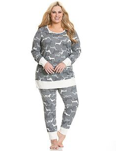 Featuring a whimsical puppy party print, our 2-piece thermal PJ set is a cute & comfy pick for sleeping or lounging. Long sleeve top and coordinating legging feature solid ribbed cuffs and easy-wearing pull-on style. Elastic waist. lanebryant.com