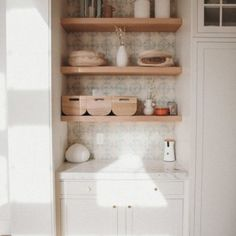 10 Creamy Kitchens with the Perfect Hint of Warmth Built In Shelves, Wood Shelves, Open Shelving, Clarks, Light Wood Texture, Amber Fillerup Clark, Leather Counter Stools, Barefoot Blonde, Woven Chair