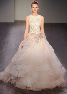 Sherbet silk organza floral printed bridal ball gown, jewel neckline front and back, dropped waist, side gathered pickup skirt layered with horsehair trimmed tulle, chapel train. Also available in Solid Ivory.