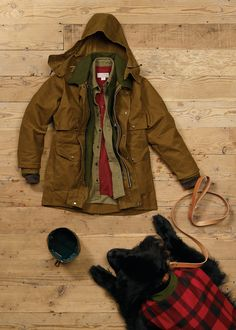 www.Filson.com | The Tin Packer: Our Toughest Coat.  At it's core, the Filson Tin Packer is our 100-year-old Cruiser that has been wrapped in an additional layer of industrial-strength waxed cotton. Like all Filson products, it is guaranteed to last a lifetime.