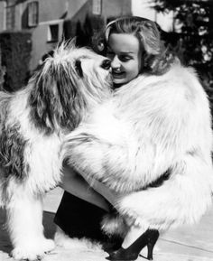 Carole Lombard in 1938, with a sheepdog given to her by Clark Gable. ShadyOaks: I need those shoes in every color.