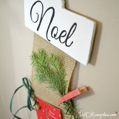 DIY hanging Christmas card holder that you can customize differently each year with baubles & trinkets, greenery & ribbons.  Tutorial with free downloadable patterns. Easy to make and a beautiful way to display Christmas cards.