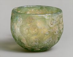 Bowl with wheel-cut facets    Period:      Sasanian  Date:      ca. 6th–7th century A.D.  Geography:      Iran  Culture:      Sasanian  Medium:      Glass; yellow-green  Dimensions:      H. 7.9 cm  Classification:      Glass-Vessel  Credit Line:      Rogers Fund, 1959