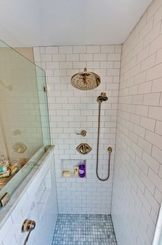 Matte white subway tile shower, hidden recessed niches, polished nickel fittings, marble mosaic flooring.  Case Remodeling of Charlotte, NC. Photography by Neffworks