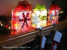 Glass Christmas Light Gift Boxes (with flat ornaments on front). Place these cheerful glass presents on the mantle, kitchen counter, in a window well, or under the Christmas tree.