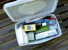 Car first aid kit fit into a baby wipe container.