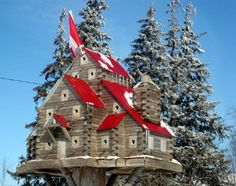 Extreme Birdhouses (mk) like the red roof, white windows with brown grey house Bird Cages, Bird Feeders, Birdhouse Designs, Unique Birdhouses, Birdhouse Ideas, Bird Houses Diy, Houses Houses, Red Roof, Backyard Birds
