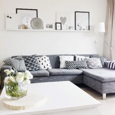 love the narrow shelving above this sofa in this living room, great gallery look to display your photos