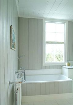 windows Bath: Panelled Bath Roundup : Remodelista via Joelle Simple panel side to the bath Wood Panel Bathroom, Bath Panel, Bathroom Paneling, Bathroom Cladding, Upstairs Bathrooms, Downstairs Bathroom, Cottage Bathrooms, Coastal Bathrooms, Grey Bathrooms