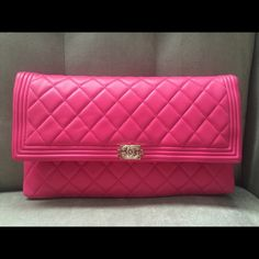 """Brand New Chanel Boy Pink Lamb Fold Over Clutch Gorgeous hot pink lambskin Chanel Boy quilted fold over clutch. Brand new and never used. Comes with authenticity card, dust bag and box. Zipper closures. Dimensions: Approximately 11"""" X 1"""" X 6.5"""" CHANEL Bags Clutches & Wristlets"""
