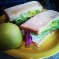 Veggie Sandwiches are the best sandwiches  This one is filled with guac, banana peppers, lettuce, pickles, red onions, tomato, cucumber, & mustard  #veganism #yum #sandwich #lunch #happymonday #foodie #veganfoodshare #lunchtime #apple #veggies #fruit #healthy #eatclean #redonion #lettuce #tomato #guac #veganfood #bananapeppers #cucumber #mustard #veganlife #foodpic #foodporn #veganfoodie #foods #foodaholic #food