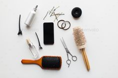 smartphone, scissors, brushes and other hair tools by dolgachov. hair tools, beauty and hairdressing concept ¨C smartphone, scissors, brushes and styling sprays with pins and ties on ...