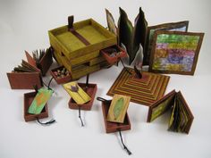 ♥♥ ♥ Cubbyhole Book Arts by Randi Parkhurst is more about the box but oh the fun of making books to fit the compartments. ♥