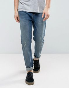 Find the best selection of ASOS Tapered Jeans In Mid Wash Blue. Shop today with free delivery and returns (Ts&Cs apply) with ASOS! Mens Bootcut Jeans, Biker Jeans, Slim Jeans, Ripped Jeans, Men's Jeans, Best White Jeans, How To Wear Sneakers, Buy Jeans, Acid Wash Jeans