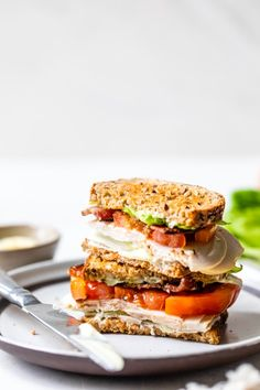 A classic Turkey Club sandwich made healthy, piled high with turkey breast, bacon, lettuce, and tomato on whole grain bread, the perfect easy lunch. #turkey #sandwich #turkeyclub