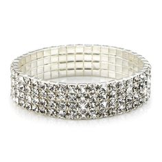 Stretch jewelry is in! This stunning bracelet is a must have! Encrusted with clear round swarovski crystals set in a secure four prong setting this stretch bracelet is absolutely breathtaking. The bracelet is made of white metal and measures 1/2 an inch wide. Bracelet fits most.