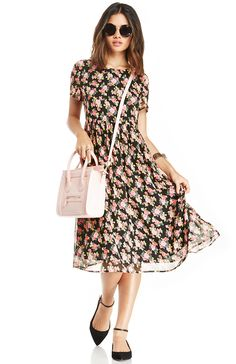 Floral dresses can be a dime a dozen, but sometimes a unique dress comes along that stands out from all of the rest. The floral dress featured here has a great silhouette that is sweet and fresh, a great select for those who love the style sensibility of the Femme Nouveau.