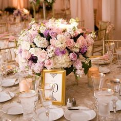 Pastel hued centerpiece // Hidden Garden Floral Design // Photo by David Michael