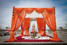 Mandap - like the concept, but I'd change up the colors and have fewer swags up top (two dips instead of four)