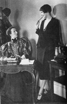 Lois Long (right) pictured in her office at the New Yorker. Early 1920s. Long (1901-1974) was the archetypal flapper: intelligent, beautiful and daring, she wrote insightful and witty commentary about fashion and NYC nightlife in the speakeasies for the brand new magazine The New Yorker.
