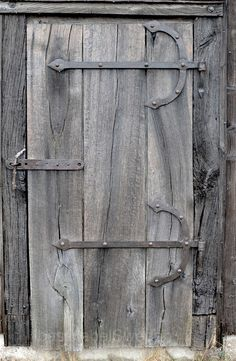 Weathered to driftwood grey, lovely old wooden door with anchor hinges