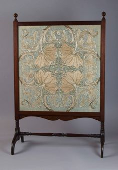 "William Morris (1834-1896) - Morris and Company - Embroidered Fire Screen. Turned Wood with Embroidered Screen. Circa 1880. 34"" x 22""."