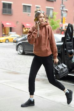on the run with Gigi Hadid in a pullover hoodie and leggings