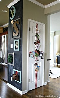 Great way to decorate the odd door we have and turn it into a holiday card display. (With Blue & silver ribbon!)