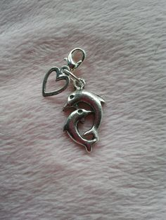 Silver coloured metal 2 dolphins charm with by CraftyBunnyDog, £1.99