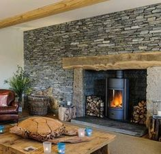 wood mantel, stone corners, stuv