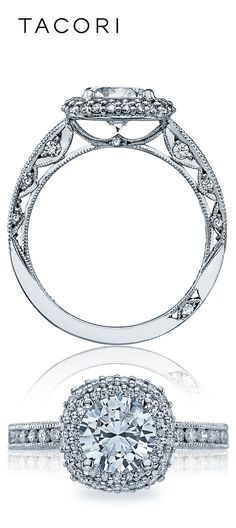 A cushion-shaped double bloom creates a vintage, glittering look, amping up the volume on a round center diamond. With botanical tendril details under the carriage of the center diamond, diamond crescent silhouettes decorate the sides for an engagement ring that is beautiful from every angle.