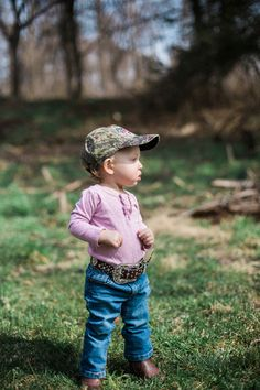 Althouse Photography // www.althousephotography.com #cowboyboots #oneyearsession #oneyearold #camohat #mossyoak #westernbelt #countrybaby #bluejeans