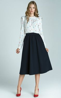 Black midi skirt with polka dot blouse