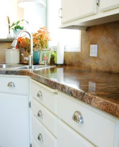 Furniture. Pleasant Design Ideas Of Stained Concrete Countertops. Trendy Design Stained Concrete Countertop Featuring Brown Color Stained Concrete Countertop And White Wooden Kitchen Storage Cabinets