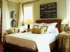 A queen-size platform bed dominates this master bedroom. Crafted from split-and-woven rattan and accented with braided leather, this West Indies-influenced piece is in keeping with the surrounding breezy architecture. Above the bed, a collage of oil paintings by local artist Janet Powers reflects her view of this islands marshy landscape. (Photo: Photo: Jean Allsopp)